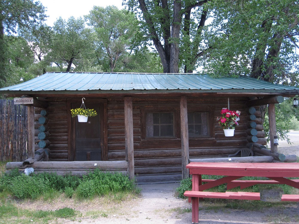 rustic blue moose near lodge the in hole cabins winter wyoming cabin jackson rentals vacation